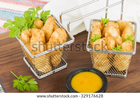 Chicken Goujons- Breaded and deep fried chicken pieces. Served with amarillo chilli sauce. - stock photo