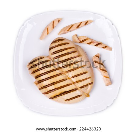 Chicken grilled fillet with slices on plate. Isolated on a white background. - stock photo