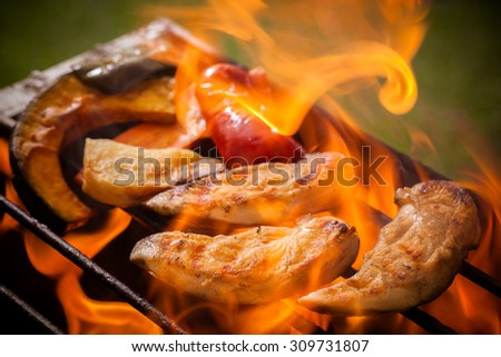 Chicken  grilling on a barbecue