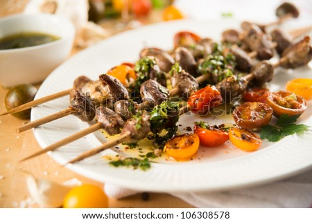 Chicken Hearts Grilled with Heirloom Cherry Tomatoes on Wooden Skewers - stock photo