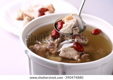 Chicken herbal soup - stock photo