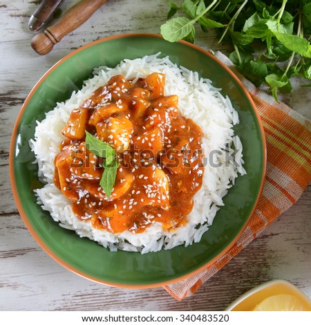 Chicken in caribbean style with pineapple and rice - stock photo