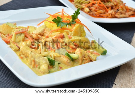 Chicken in curry sauce with rice - stock photo