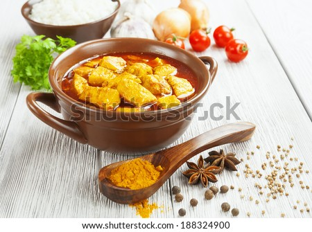 Chicken in spicy sauce in the bowl on the table  - stock photo