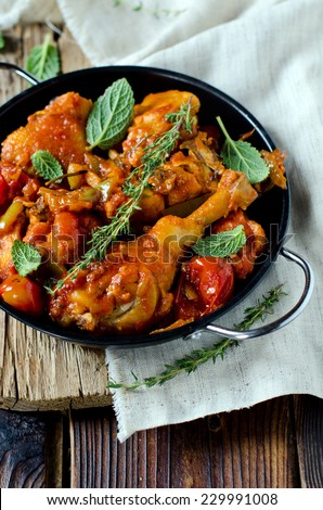 Chicken in tomato sauce with rosemary and thyme - stock photo