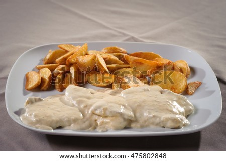 Chicken in white  sauce with roasted potatoes