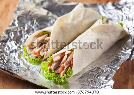 chicken kebab on aluminium foil - stock photo