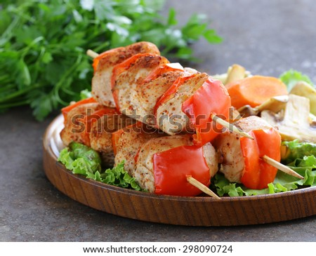 Chicken kebab with bell pepper on wooden skewers - stock photo