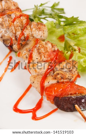 Chicken kebab with tomato sauce