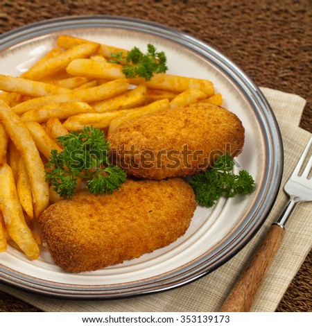 Chicken Kiev Cutlet. Boneless chicken breast with butter and herbs. Selective focus.