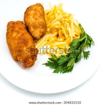 Chicken Kiev with roasted potatoes on white plate - stock photo