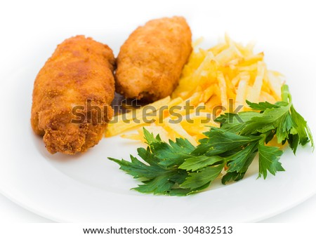 Chicken Kiev with roasted potatoes on white plate