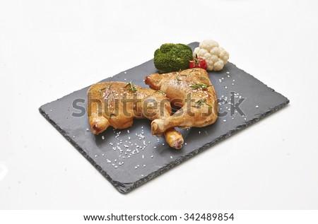 chicken leg black plate - stock photo
