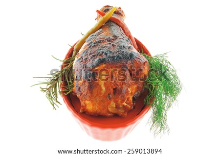 chicken leg over red bowl on white - stock photo