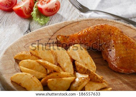 chicken leg with fried potatoes