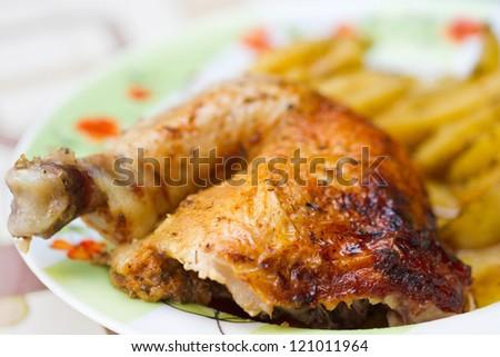 Chicken leg with potatos. Picture proper for menu design. - stock photo