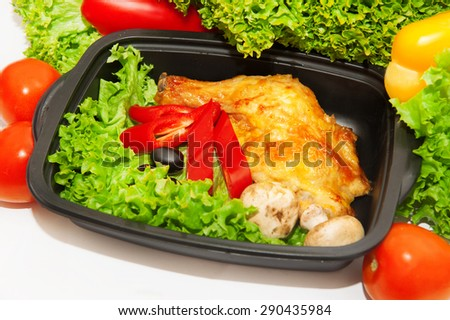 Chicken leg with vegetables in a box for lunch - stock photo
