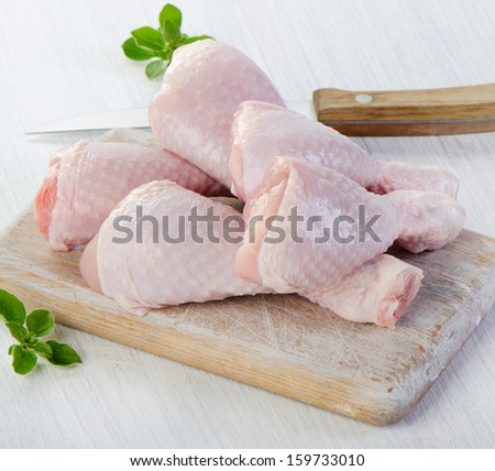 Chicken legs on a wooden table. Selective focus
