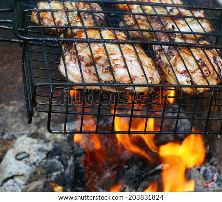 Chicken legs on the grill for barbecue - stock photo
