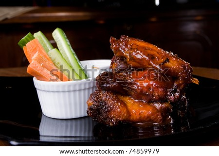 Chicken legs with some vegetables - stock photo