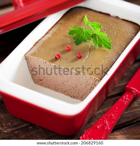 Chicken liver pate in terrine form, selective focus - stock photo