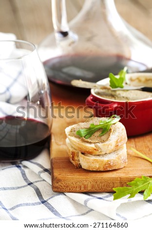 Chicken liver pate on bread and wine - stock photo