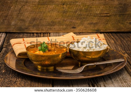 Chicken madras served with white basmati rice. - stock photo
