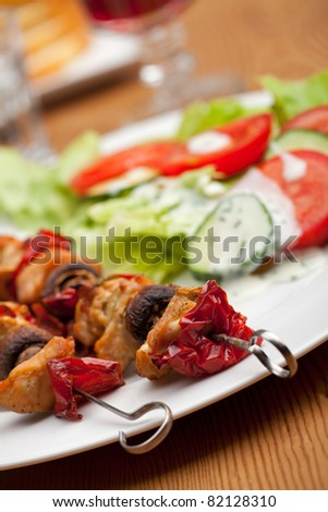 chicken meat on skewers and salad - stock photo