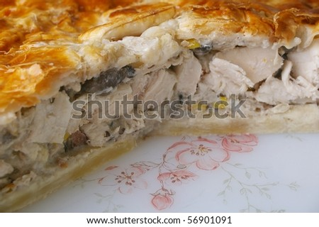 chicken meat pie or pot pie with short crust and flaky pastry - stock photo