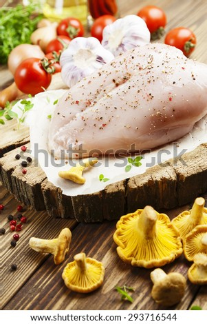 Chicken meat with vegetables and chanterelles on the table