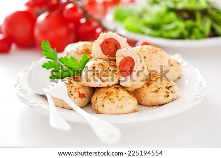 Chicken meatballs stuffed with cherry tomatoes, selective focus - stock photo