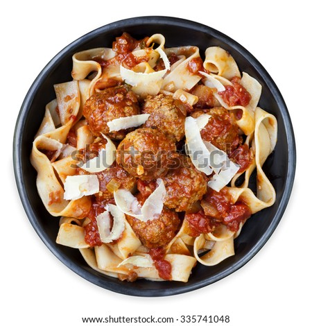 Chicken meatballs with pappardelle ribbon pasta and parmesan.  Overhead view, isolated. - stock photo