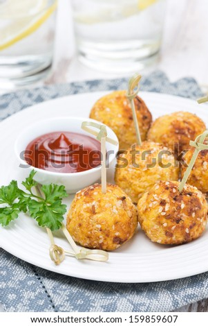 chicken meatballs with tomato sauce, close-up, vertical photo