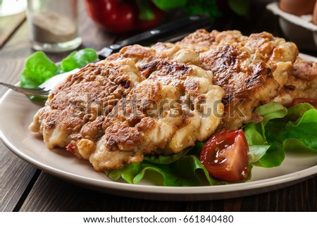 Chicken Medallion with red pepper portions served on a plate