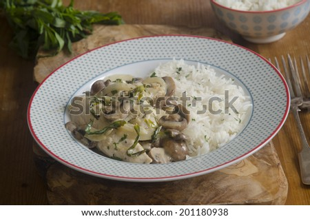 Chicken, mushroom and tarragon fricassee served with basmati rice - stock photo