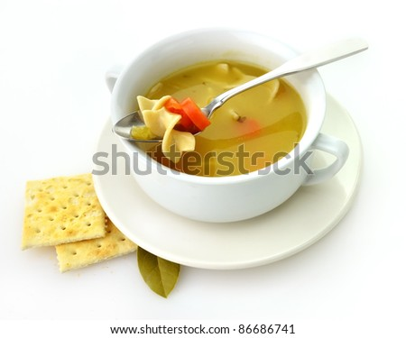 Chicken noodle soup in a white cup with crackers - stock photo