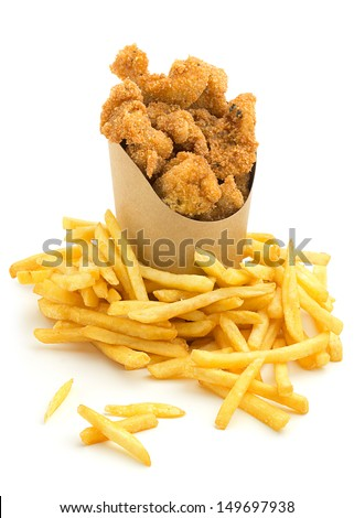 chicken nuggets and french fries on white background - stock photo