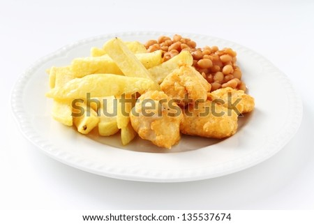chicken nuggets chunky fries and baked beans - stock photo