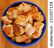 Chicken nuggets in blue plate on wooden table. - stock photo