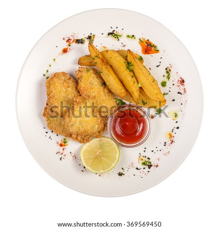 Chicken nuggets, potatoes and sweet chili sauce isolated on white background - stock photo