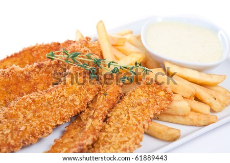 Chicken nuggets with french fries and yogurt sauce - stock photo