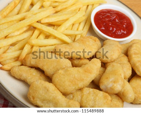 Chicken nuggets with fries and tomato ketchup. - stock photo