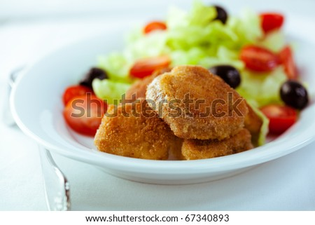 Chicken nuggets with salad - stock photo