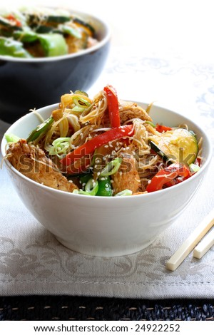 Chicken or pork stir fry with vegetables and rice noodles. - stock photo
