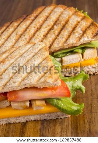 Chicken panini grilled Italian sandwich - stock photo