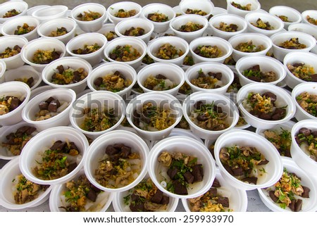 Chicken Paste of rice flour many cups lined foam, which is to feed children. - stock photo