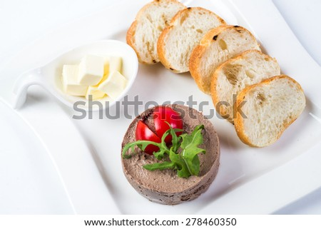 Chicken pate in jar and sliced bread - stock photo