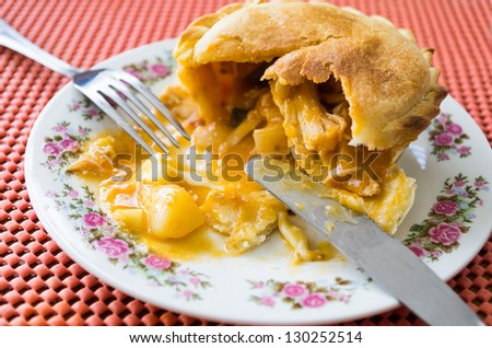chicken pie on plate with flowers - stock photo