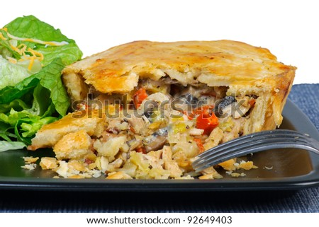 Chicken Pot-Pie dinner with fresh bread and side salad. - stock photo