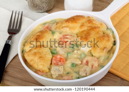 Chicken pot pie meal with carrots and peas - stock photo